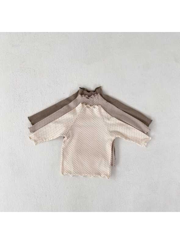 Krémovo biely detský top s bodkami